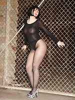 Pantyhose Diva posing in front of the fence | PantyhoseDiva.com