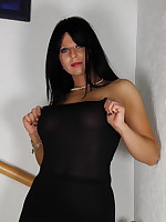 Attractive Pantyhose Diva posing in her black dress | PantyhoseDiva.com
