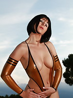 Desyra Noir posing in bronze latex stockings | DesyraNoir.com