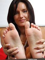 Thin vixen Sharon licks her bare feet