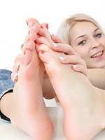 Blonde amateur babe massaging her handsome foot