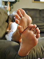 Sexy Nikki shows Her perfect feet and toes with white polish.